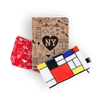 A brown notebook with NY in a heart and famous NYC sites flanked by two pencil cases, one red with NYC sites in white and the other a modern Mondrian print, that are some of the featured items that can be found at the Signature Theatre bookstore